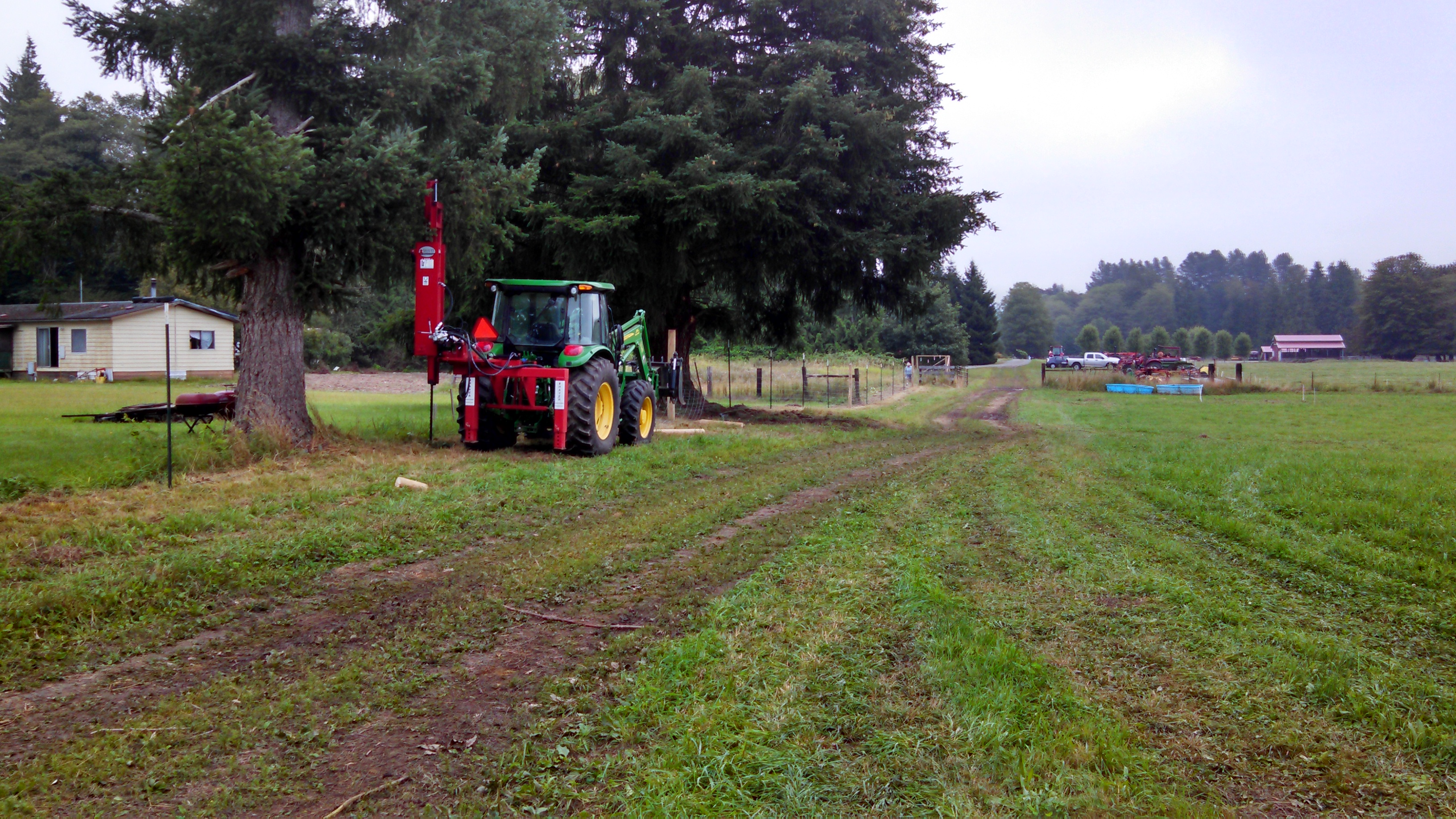 Tulalip Tribes Natural Resources Department news link to Tribes Survey Nooksack Herd Using Elk Scat with image of tractor near trees in field